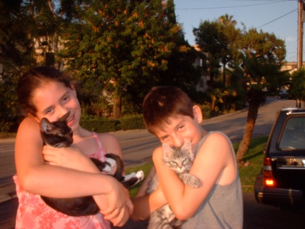 "A decade ago, Bop and Luna were kittens and my son (now 6'2) was shorter than his twin sister (now 5'10"")."